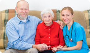 Elderly couple with their nurse